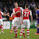 Arsenal's Per Mertesacker, left, talks to Arsenal teammate Calum Chambers following the end the Group D Champions League match between Anderlecht and Arsenal at Constant Vanden Stock Stadium in Brussels, Belgium, Wednesday Oct. 22, 2014. Arsenal won the