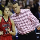Louisville head coach Jeff Walz and Jude Schimmel (22) talk on the sideline against California in the first half of a national semifinal at the Women's Final Four of the NCAA college basketball tournament, Sunday, April 7, 2013, in New Orleans. (AP Photo/Dave Martin)