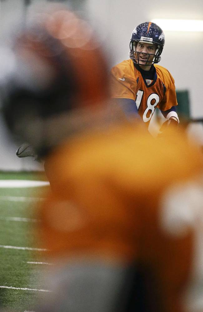Denver Broncos quarterback Peyton Manning (18) passes to a receiver during practice Thursday, Jan. 30, 2014, in Florham Park, N.J. The Broncos are scheduled to play the Seattle Seahawks in the NFL Super Bowl XLVIII football game Sunday, Feb. 2, in East Rutherford, N.J. (AP Photo)