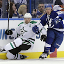 Tampa Bay Lightning right wing Ryan Callahan (24) takes down Dallas Stars center Vernon Fiddler during the first period of an NHL preseason hockey game Friday, Sept. 26, 2014, in Tampa, Fla. The Associated Press