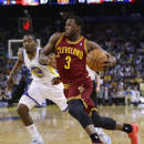 Cleveland Cavaliers guard Dion Waiters (3) dribbles past guard Jordan Crawford (55) during the first half of an NBA basketball game on Friday, March 14, 2014, in Oakland, Calif. (AP Photo/Marcio Jose Sanchez)