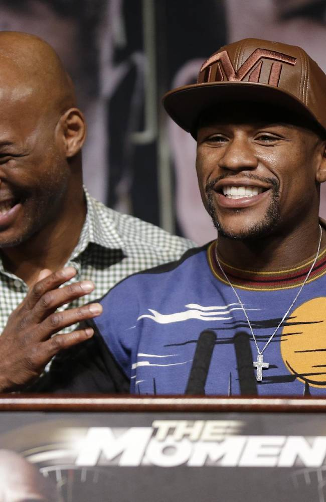 Boxers Bernard Hopkins, left, and Floyd Mayweather Jr. laugh during a news conference Wednesday, April 30, 2014, in Las Vegas. Mayweather will face Marcos Maidana in a welterweight title fight on Saturday, May 3