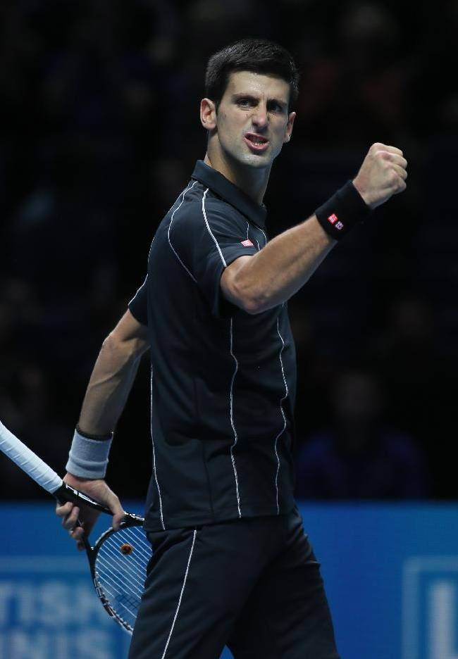 Novak Djokovic of Serbia celebrates at match point as he defeats Richard Gasquet of France in their ATP world Tour Finals tennis match at the O2 Arena on London, Saturday, Nov. 9, 2013