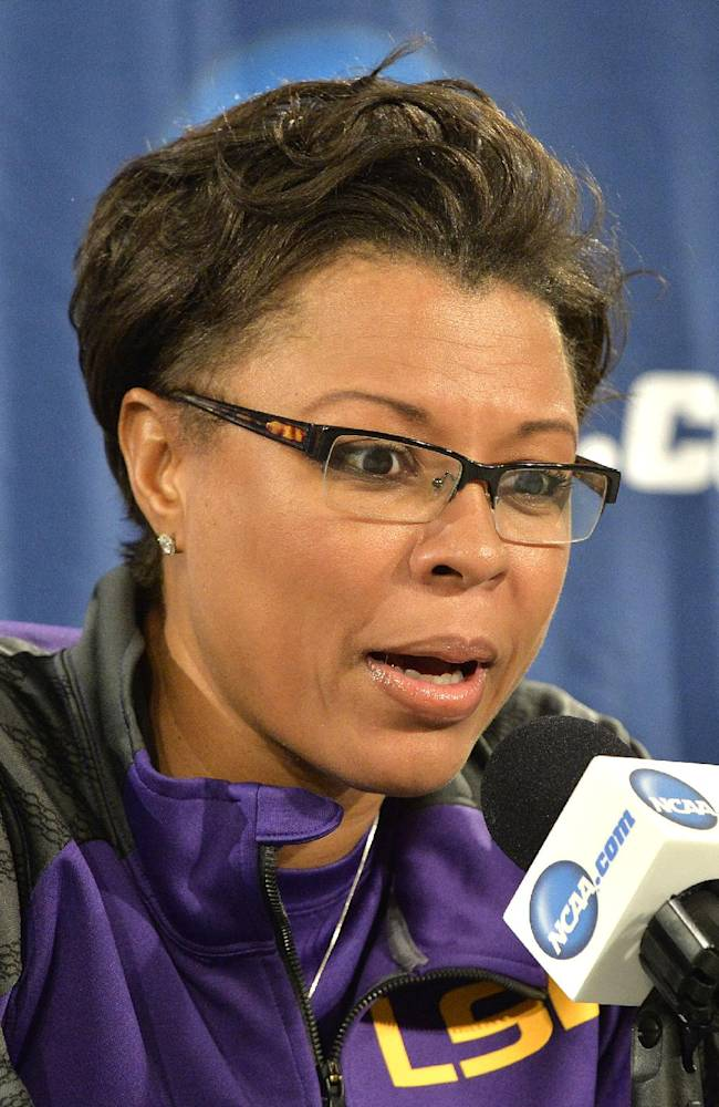 LSU head coach Nikki Caldwell responds to a question during a news conference at the NCAA women's college basketball tournament in Louisville, Ky., Saturday, March 29, 2014. LSU is scheduled to play Louisville in a regional semifinal on Sunday