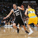 San Antonio Spurs guard Manu Ginobili, left, of Argentina, pursues a loose ball with Denver Nuggets guard Evan Fournier, of France, in the third quarter of the Spurs' 133-102 victory in an NBA basketball game in Denver, Friday, March 28, 2014 The Associat