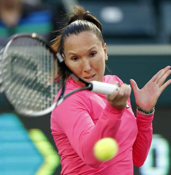 Jelena Jankovic, of Serbia, returns to Lauren Davis during the Family Circle Cup tennis tournament in Charleston, S.C., Wednesday, April 2, 2014