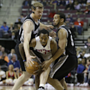 Detroit Pistons guard Brandon Jennings (7) is defended by San Antonio Spurs forward Matt Bonner, left, and Cory Joseph during the second half of an NBA basketball game in Auburn Hills, Mich., Monday, Feb. 10, 2014 The Associated Press