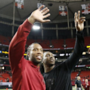 Arizona Cardinals wide receiver Larry Fitzgerald, left, and Atlanta Falcons Roddy White wave after the second half of an NFL football game between the Atlanta Falcons and the Arizona Cardinals, Sunday, Nov. 30, 2014, in Atlanta The Associated Press