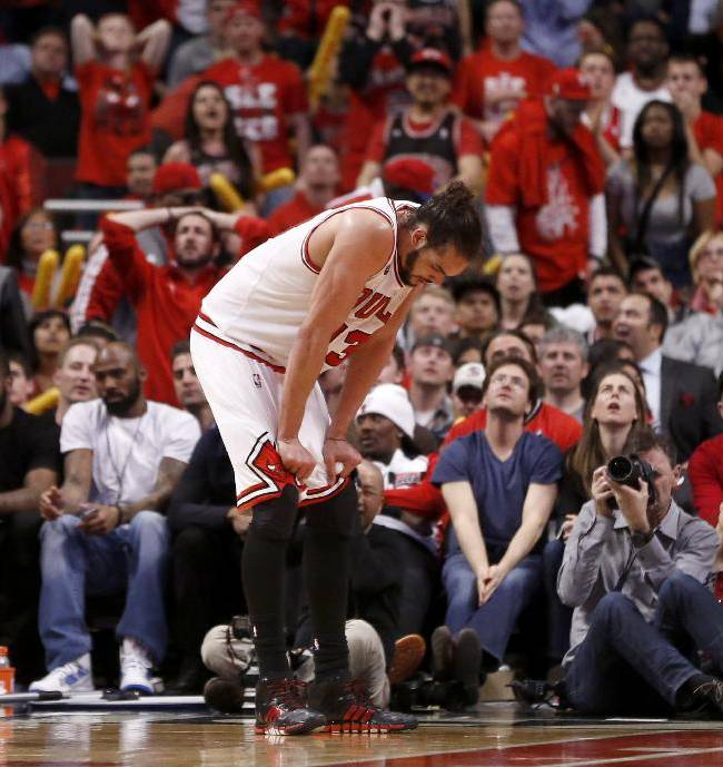 Chicago Bulls center Joakim Noah puts his head down during the overtime period of Game 2 in an opening-round NBA basketball playoff series against the Washington Wizards Tuesday, April 22, 2014, in Chicago. The Wizards won 101-99