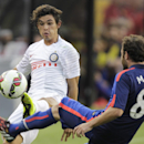 Inter Milan's Dodo, left, and Manchester United's Juan Mata (8) kick the ball during the first half of a soccer game at the 2014 Guinness International Champions Cup, Tuesday, July 29, 2014, in Landover, Md. Manchester United won 5-3 in a penalty kick sh
