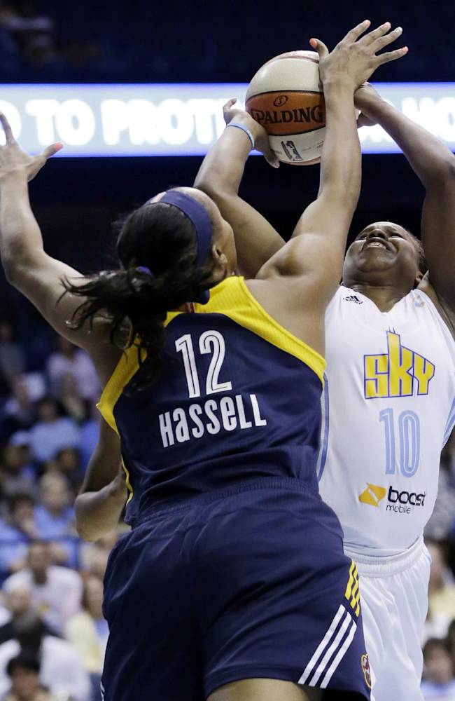 Indiana Fever forward Jasmine Hassell (12) blocks a shot by Chicago Sky guard Epiphanny Prince during the second half in Game 1 of the WNBA basketball Eastern Conference semifinal series on Friday, Sept. 20, 2013, in Rosemont, Ill. The Fever won 85-72