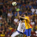 Chelsea FC forward Loïc Rémy (18) and FC Barcelona defender Thomas Vermaelen (23) in action on Tuesday,July,28,2015, in Landover, Maryland. Chelsea and FC Barcelona face off at the 2015 International Champions Cup. Damian Strohmeyer/AP Images for Interna