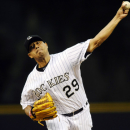 Colorado Rockies starting pitcher Jorge De La Rosa throws in the first inning of a baseball game against the Los Angeles Dodgers, Wednesday, Sept. 4, 2013 in Denver. (AP Photo/Chris Schneider)