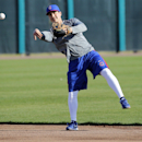 Chicago Cubs' Darwin Barney throws prior to the team's first spring training baseball practice, Friday, Feb. 14, 2014, in Peoria, Ariz The Associated Press