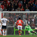 Benfica's Lima, left, scores their second goal from the penalty spot past Tottenham Hotspur's goalkeeper Brad Friedel, right, during their Europa League round of 16, second leg, soccer match Thursday, March 20 2014, at Benfica's Luz stadium