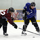 Colorado Avalanche left winger Gabrial Landeskog, left, and center Matt Duchene vie for the puck during the first day of NHL hockey training camp, Friday, Sept. 19, 2014, in Centennial, Colo The Associated Press