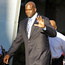 Shaquille O'Neal, minority owner of the Sacramento Kings, arrives before the start of an NBA basketball game between the Denver Nuggets and the Sacramento Kings, Wednesday, Oct. 30, 2013, in Sacramento. (AP Photo/Genevieve Ross)