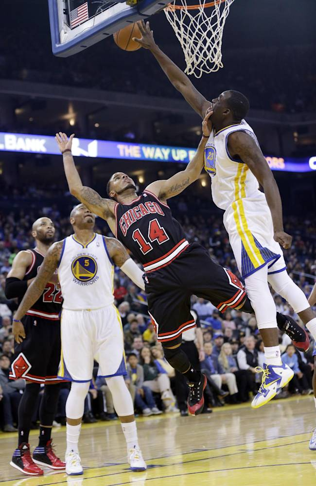 Golden State Warriors' Draymond Green (23) blocks a layup attempt by Chicago Bulls' D.J. Augustin (14) during the first half of an NBA basketball game, Thursday, Feb. 6, 2014, in Oakland, Calif