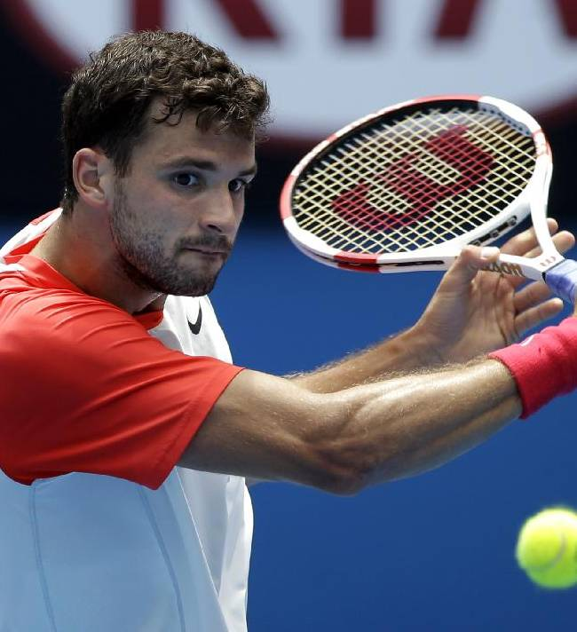 Grigor Dimitrov of Bulgaria hits a backhand return to Roberto Bautista Agut of Spain during their fourth round match at the Australian Open tennis championship in Melbourne, Australia, Monday, Jan. 20, 2014