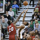 Utah Jazz's Alec Burks (10) shoots as Miami Heat's Greg Oden (20) defends and Heat's Ray Allen (34) watches during the second quarter of an NBA basketball game Saturday, Feb. 8, 2014, in Salt Lake City The Associated Press