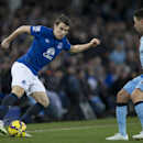 Everton's Seamus Coleman, left, keeps the ball from Manchester City's Samir Nasri during the English Premier League soccer match between Everton and Manchester City at Goodison Park Stadium, Liverpool, England, Saturday Jan. 10, 2015