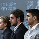 Chicago Blackhawks' Patrick Kane, left, Los Angeles Kings' Anze Kopitar, center, and Boston Bruins Patrice Bergeron listen as NHL Commissioner Gary Bettman announces the return of the World Cup of Hockey in 2016 in Toronto, during a news conference at Nat