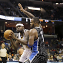 Memphis Grizzlies' Zach Randolph, left, is defended by Orlando Magic's Glen Davis in the second half of an NBA basketball game in Memphis, Tenn., Monday, Dec. 9, 2013. Randolph made 19 points as the Grizzlies won 94-85 The Associated Press