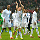 Manchester City's James Milner, center, applauds after the Champions League group D soccer match between FC Bayern Munich and Manchester City, in Munich, southern Germany, Tuesday, Dec. 10, 2013. Manchester defeated Munich by 3-2