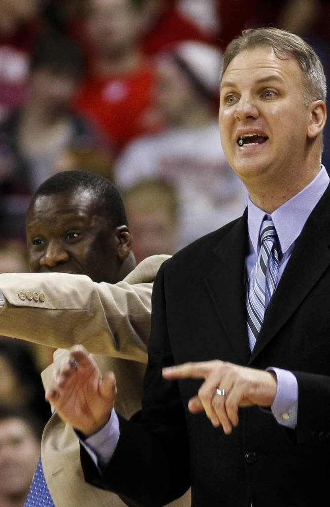 North Dakota coach Brian Jones, right, and assistant coach Gameli Ahelegbe direct their team during the first half of an NCAA college basketball game against Wisconsin Tuesday, Nov. 19, 2013, in Madison, Wis