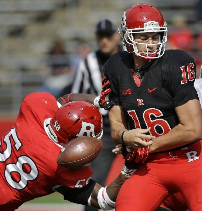 Rutgers White quarterback Mike Bimonte (16) has the ball stripped by Scarlett defensive end Kemoko Turay (58) during the second half of their spring NCAA college football game in Piscataway, N.J., Saturday, April 26, 2014