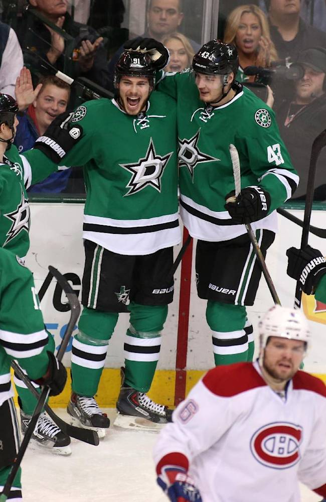 Dallas Stars' Rich Peverly (17),  Cody Eakin (20),Tyler Seguin (91), Valeri Nichushkin (43), of Russia, and Kevin Connauton (23) celebrate a goal as Montreal Canadiens Douglas Murray (6) skates away during the third period of an NHL hockey game Thursday, Jan. 2, 2014, in Dallas. Montreal won 6-4
