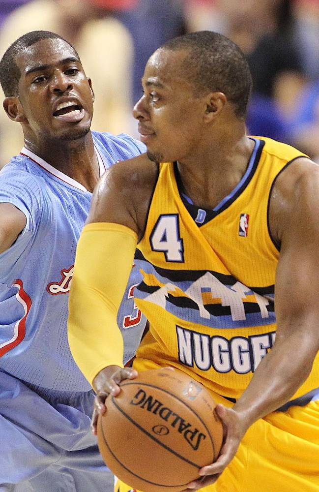The Los Angeles Clippers' Chris Paul covers the Denver Nuggets' Randy Foye during the first half of a preseason NBA basketball game on Saturday, Oct. 19, 2013, in Las Vegas