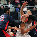 Robert Morris forwards Lucky Jones (22) and Mike McFadden, right, pressure Providence forward Kadeem Batts (10) into a traveling violation during the first half of a second-round NIT college basketball game in Providence, R.I., Monday, March 25, 2013. (AP Photo/Stew Milne)