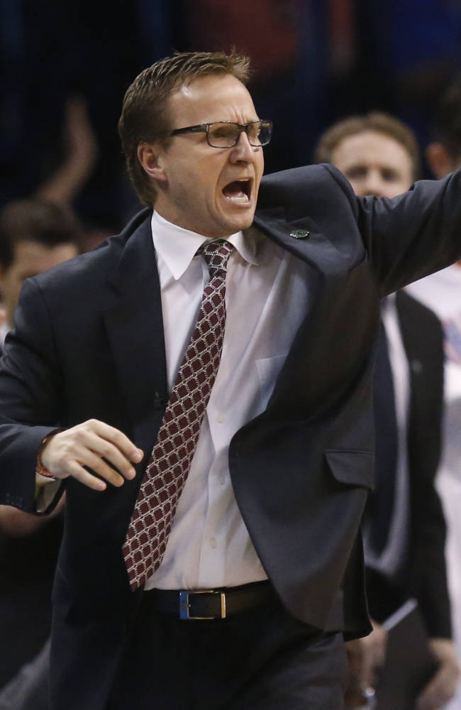 Oklahoma City Thunder coach Scott Brooks shouts to his team in the fourth quarter of an NBA basketball game against the San Antonio Spurs in Oklahoma City, Thursday, April 3, 2014. Oklahoma City won 106-94