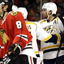 Nashville Predators' Mike Fisher, right, celebrates with teammates after scoring his goal during the first period of an NHL hockey game against the Chicago Blackhawks in Chicago, Sunday, March 23, 2014 The Associated Press