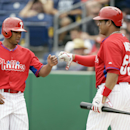 Philadelphia Phillies center fielder Ben Revere, left, celebrates with teammate Bobby Abreu after scoring during the first inning of an exhibition baseball game against the Toronto Blue Jays Wednesday, Feb. 26, 2014, in Clearwater, Fla The Associated Pres