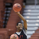 San Diego State guard Xavier Thames passes a ball during practice at the NCAA men's college basketball tournament, Wednesday, March 26, 2014, in Anaheim, Calif. San Diego State is scheduled to play Arizona on Thursday in a regional semifinal The Associate