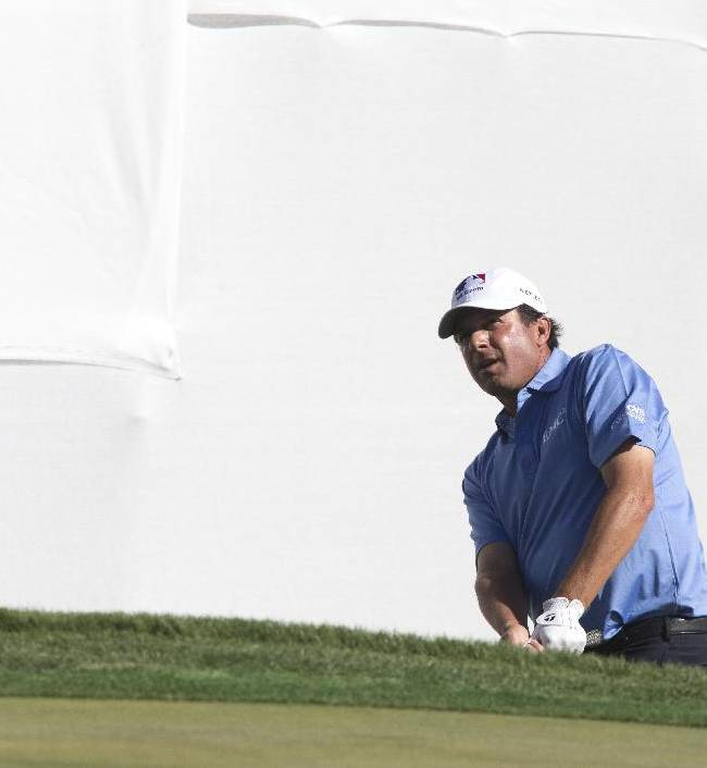 Billy Andrade chips on to the ninth hole during the second round of the Charles Schwab Cup Championship golf tournament Friday, Oct. 31, 2014, in Scottsdale, Ariz