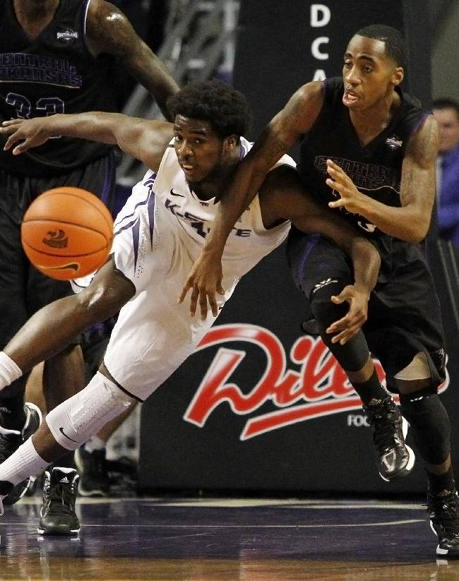 Kansas State's Nino Williams, left, and Central Arkansas' Oliver Wells, right, go after a loose ball during the first half of an NCAA college basketball game in Manhattan, Kan, Sunday, Dec. 1, 2013