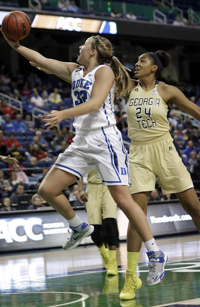 Duke's Tricia Liston (32) drives past Georgia Tech's Shayla Bivins (24) during the first half of an NCAA college basketball game at the Atlantic Coast Conference tournament in Greensboro, N.C., Friday, March 7, 2014