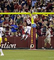 Washington Redskins linebacker Ryan Kerrigan (91) celebrates his touchdown during the first half of an NFL preseason football game against the Pittsburgh Steelers, Monday, Aug. 19, 2013, in Landover, Md. (AP Photo/Patrick Semansky)
