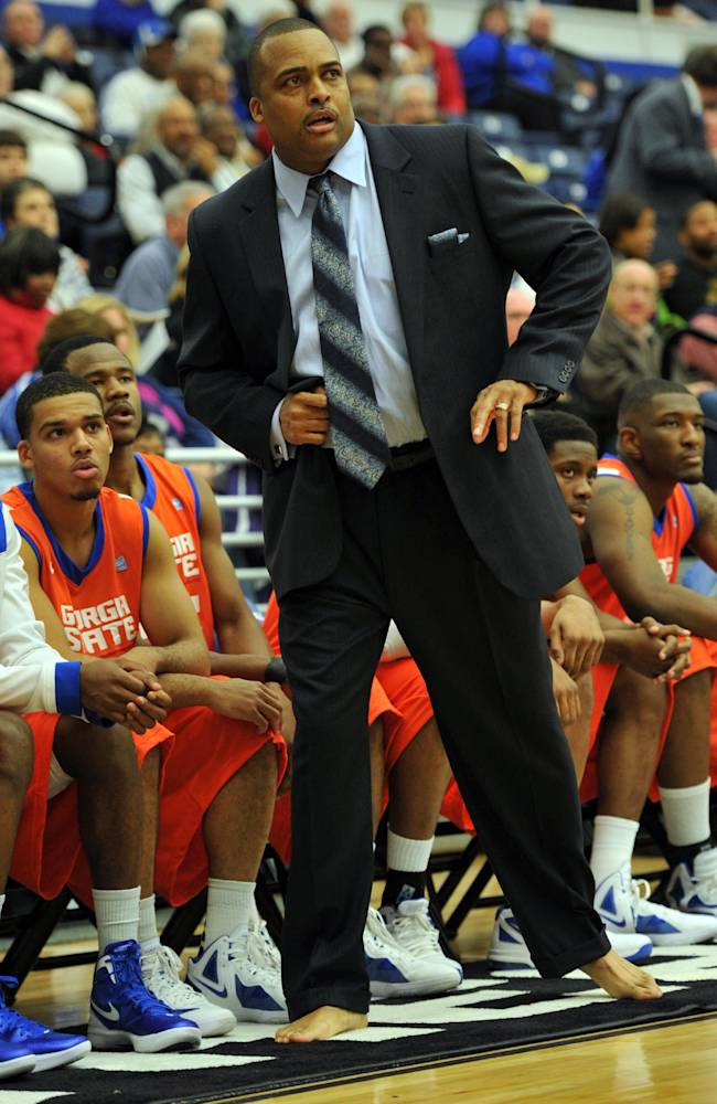 In this photo taken on Jan. 12, 2012, Georgia State coach Ron Hunter coaches barefoot during the first half of an NCAA college basketball game against North Carolina-Wilmington in Atlanta. Hunter coaches one game each year barefooted to bring attention to his charity that provides shoes to millions of poor children around the world