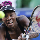 Venus Williams of the United States returns the ball against Petra Kvitova of the Czech Republic during their semi-final match of the Pan Pacific Open tennis tournament in Tokyo, Friday, Sept. 27, 2013. (AP Photo/Koji Sasahara)