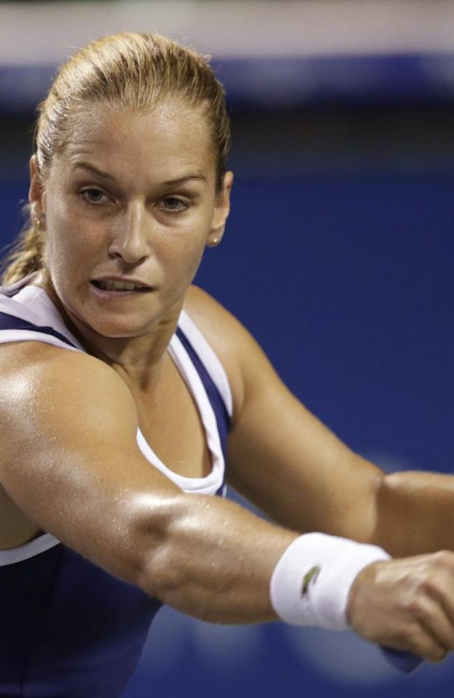 Dominika Cibulkova of Slovakia eyes on the ball as she returns a shot against Agnieszka Radwanska of Poland during their third round match of the Pan Pacific Open tennis tournament in Tokyo, Wednesday, Sept. 25, 2013