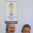 Minister of Sports Aldo Rebelo speaks during an event marking one year to the kick-off of the 2014 World Cup, at the Copacabana beach in Rio de Janeiro, Brazil, Wednesday, June 12, 2013. FIFA Secretary General Jerome Valcke is pictured right. (AP Photo/Silvia Izquierdo)