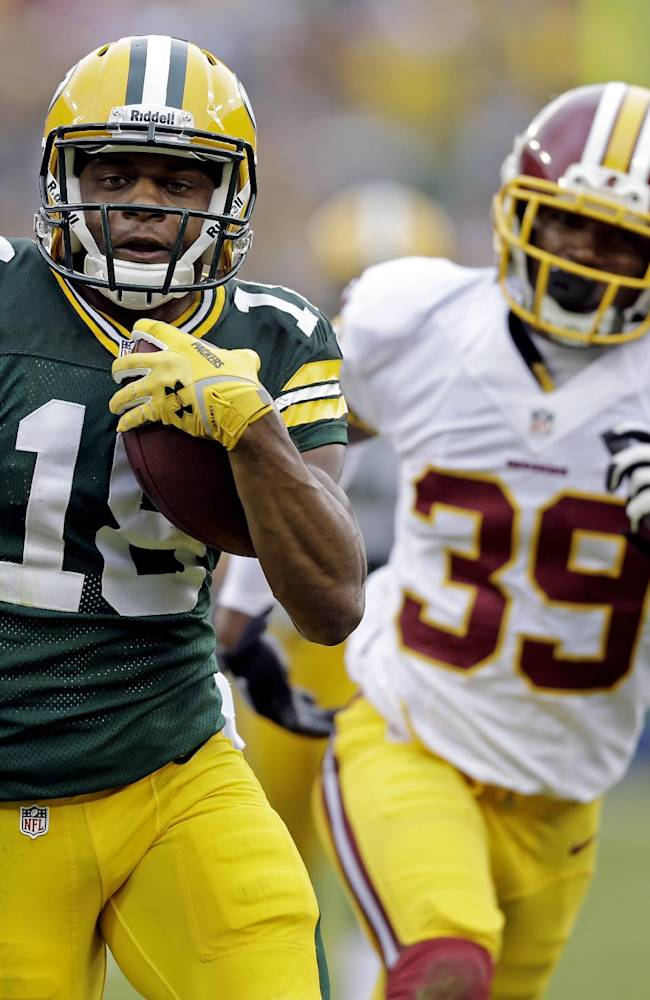 Green Bay Packers' Randall Cobb breaks away from Washington Redskins' David Amerson (39) for a 35-heard touchdown reception during the first half of an NFL football game Sunday, Sept. 15, 2013, in Green Bay, Wis