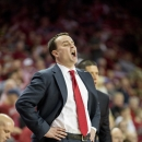 Dayton head coach Archie Miller yells a play to his defense during the first half of an NCAA college basketball game against Arkansas on Saturday, Dec. 13, 2014, in Fayetteville, Ark. (AP Photo/Gareth Patterson)