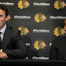 Chicago Blackhawks players Jonathan Toews, left, and Patrick Kane listen during a news conference at the United Center in Chicago, Wednesday, July 16, 2014. The Blackhawks recently agreed to eight-year contract extensions with for their star players The