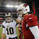 Arizona Cardinals quarterback Carson Palmer, right, greets St. Louis Rams quarterback Kellen Clemens (10) after an NFL football game, Sunday, Dec. 8, 2013, in Glendale, Ariz. The Cardinals won 30-10 The Associated Press