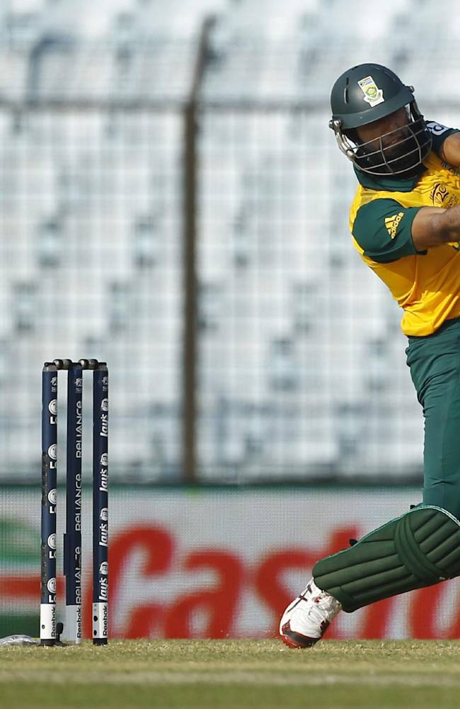 South Africa's Hashim Amla plays a shot during their ICC Twenty20 Cricket World Cup match against New Zealand in Chittagong, Bangladesh, Monday, March 24, 2014